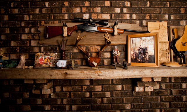 The rifle the author inherited from his grandfather rests above the mantle, outfitted with a new scope.  (Credit: Bill Konway)